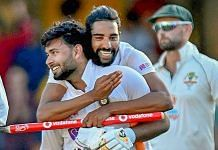 Indian players Shardul Thakur and Mohd Siraj celebrate after defeating Australia by three wickets on the final day of the fourth cricket test match at the Gabba, Brisbane, Australia, Tuesday, Jan. 19, 2021. | PTI