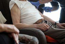 A resident receives a dose of Pfizer-BioNTech Covid vaccine at a senior citizen care home in Premnitz, Germany | Photo: Liesa Johannssen-Koppitz | Bloomberg