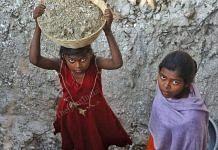 From left to right: 9 year old Chand Kumari and 16 year old Roshni Kumari carry scraps of mica | Photo: Praveen Jain | ThePrint