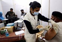 A policeman is vaccinated in Madhya Pradesh | Representational image: ANI