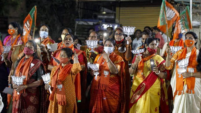 BJP supporters celebrate after emerging victorious on the counting day of Gujarat Municipal Corporation polls, in Ahmedabad, on 23 February | PTI