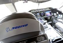 A logo sits on a pilot's seat in the cockpit of a Boeing Co. 787 Dreamliner   Photo via Bloomberg