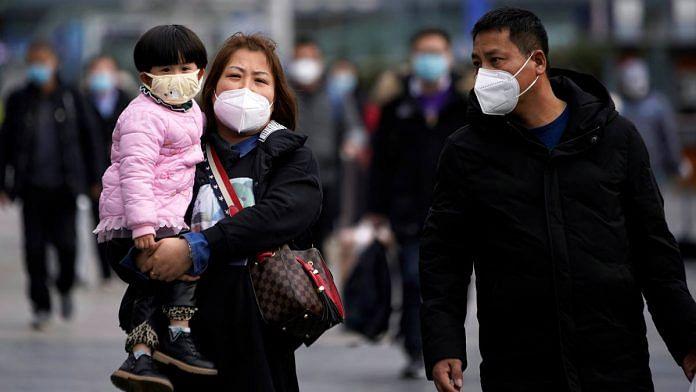 Passengers wearing masks walk outside the Shanghai railway station in Shanghai, China (Representational image) | Reuters via ANI File photo