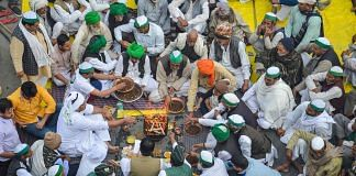 Farmers perform a puja on the occasion of Basant Panchami during their agitation against new farm laws, at Ghazipur border on 16 February | Photo: PTI