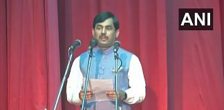 BJP's Shahnawaz Hussain takes oath as a minister in Patna Tuesday | ANI