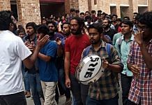 Jawaharlal Nehru University (JNU) students shout slogans during a protest against the draft hostel manual | ANI