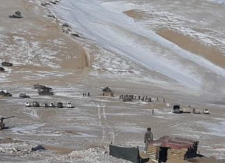 Chinese PLA troops dismantling temporary structures erected near the Pangong Tso and marching back | Photo released by Indian Army