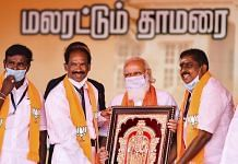 File photo | PM Modi being presented a memento by BJP leaders in Puducherry, 25 Feb 2021 | PTI