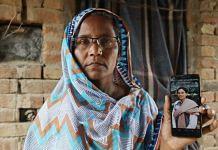 Swarnjit Kaur holds up a mobile phone with her activist daughter Nodeep Kaur's image at their home in Gandera village, Sri Muktsar Sahib district in Punjab | Photo: Manisha Mondal | ThePrint