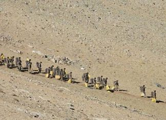 Chinese PLA troops march back from the Pangong Tso area in eastern Ladakh | Photo released by Indian Army