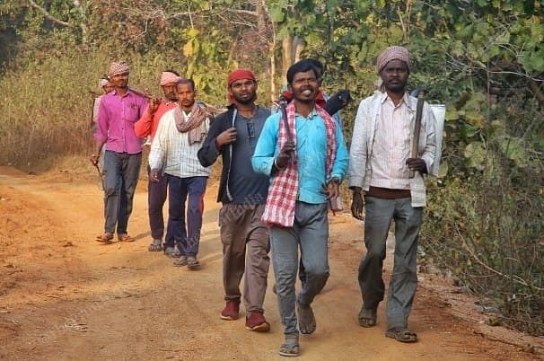 Sanjay Singh (wearing red gamcha) survived the January accident but is now back in the mines | Photo: Pravin Jain/ThePrint