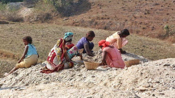 Women and children scavenge for mica near a mine in Devanjot village of Jharkhand's Giridih district | Photo: Praveen Jain/ThePrint
