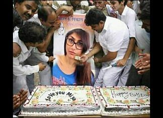 A morphed photograph of Congress workers feeding cake to a Mia Khalifa poster is viral | Twitter