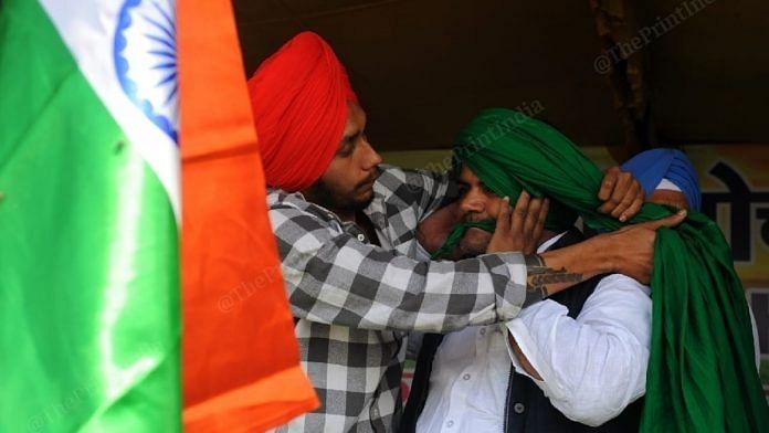 A farmer getting turban tied on 'Pagdi Sambhal Diwas' at the Ghazipur border protest site. | Photo: Suraj Singh Bisht/ThePrint