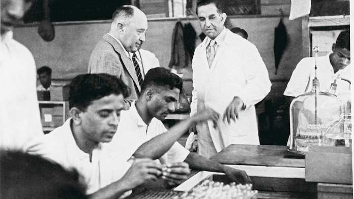 Hamid giving a tour of the ampoules department of Cipla in 1941 | © Cipla Limited