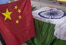 An Indian and Chinese flags at FlagSource workshop in Mumbai   Photo: Dhiraj Singh   Bloomberg