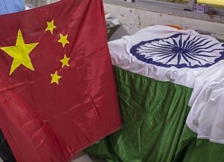 An Indian and Chinese flags at FlagSource workshop in Mumbai | Photo: Dhiraj Singh | Bloomberg