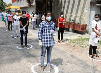 Students wait outside an exam centre as they arrive to appear for the NEET exam, in Lucknow, on 13 September 2020 | ANI File Photo
