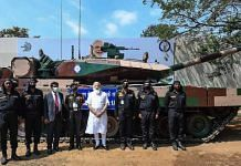 Prime Minister Narendra Modi and Army officials stand in front of a Arjun Mark 1-A tank | PTI