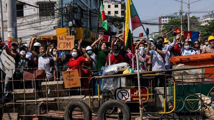 Scores arrested as Myanmar police disperse anti-coup rally