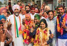 Punjab Finance Minister Manpreet Singh Badal (in white turban) with winning Congress candidates in Bathinda Wednesday | Photo: PTI