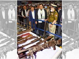 Assam Chief Minister Sarbananda Sonowal looks at arms and ammunition laid out by five militants outfits of Karbi-Anglong, during an arms laying down ceremony at Srimanta Sankardev Kalashetra in Guwahati, on 23 February | PTI