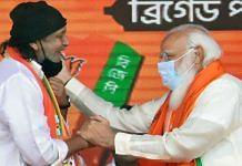 Veteran Bollywood actor Mithun Chakraborty with PM Narendra Modi at a BJP rally in Kolkata Sunday | ANI
