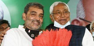 Upendra Kushwaha (left) with Nitish Kumar at the merger of his RLSP with the Bihar CM's JD(U) | Photo: ANI