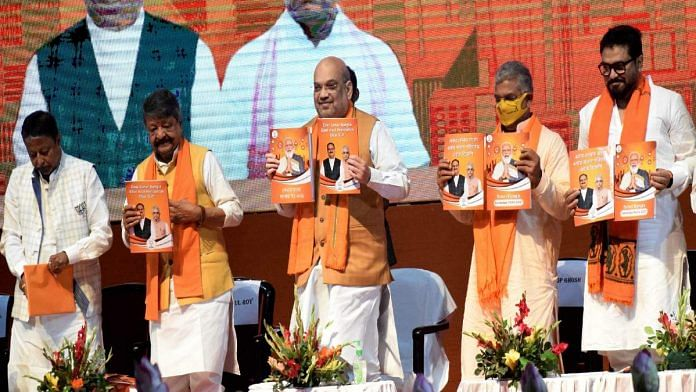 Union Home Minister Amit Shah and other BJP leaders release the BJP manifesto for the upcoming West Bengal elections in Kolkata Sunday | ANI