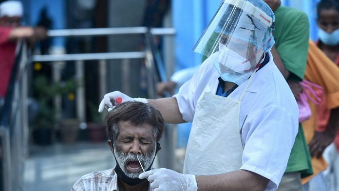 A health worker collects a swab sample for a Covid test, near Kashmere Gate in New Delhi, on 20 March 2021   Representational image   PTI