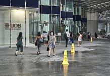 Pedestrians walk past a United Overseas Bank Ltd. (UOB) branch in the central business district in Singapore | Photographer: Lauryn Ishak | Bloomberg