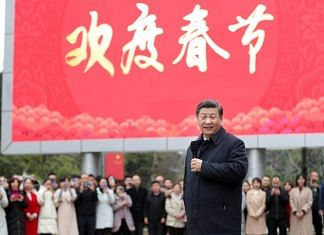Chinese President Xi Jinping talks to local residents at Jinyuan community in Guanshanhu District of Guiyang, capital of southwest China's Guizhou Province, Feb. 4, 2021. | Photographer: Ding Haitao/Xinhua | Getty Images via Bloomberg