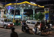 Vehicles at a petrol pump station in Bengaluru, on 4 March 2021   Photo: Dhiraj Singh   Bloomberg