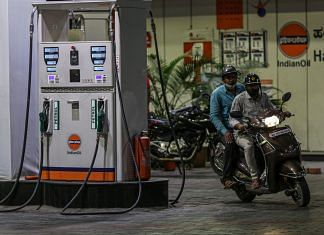 A motorcyclist exits an Indian Oil gas station in Bengaluru   Photo: Dhiraj Singh