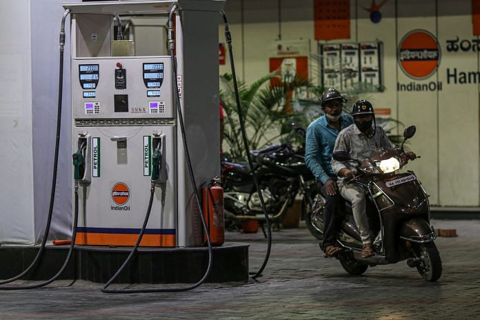 A motorcyclist exits an Indian Oil gas station in Bengaluru | Photo: Dhiraj Singh