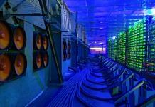 Industrial cooling fans operate to thermally regulate illuminated mining rigs at the CryptoUniverse cryptocurrency mining farm in Nadvoitsy, Russia | Representational Image | Photographer: Andrey Rudakov | Bloomberg