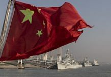 A Chinese national flag flies from a ferry on the Yangtze River in Wuhan, Hubei   Photo: Qilai Shen   Bloomberg