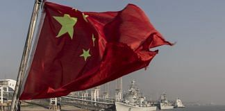 A Chinese national flag flies from a ferry on the Yangtze River in Wuhan, Hubei | Photo: Qilai Shen | Bloomberg