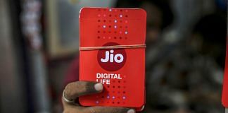 Reliance Jio sim card packets at a store in Mumbai | Image via Bloomberg