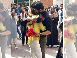 A still from the viral video of two students hugging on the campus of Lahore University | Twitter