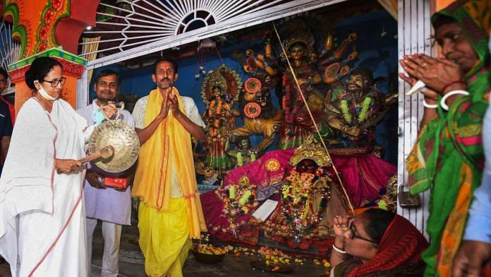 West Bengal CM Mamata Banerjee visits a temple, during an election campaign ahead of state assembly polls, in Nandigram, on 9 March 2021 | PTI