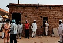 Farmers in front of a concrete structure raised at Tikri border | Shubhangi Misra | ThePrint