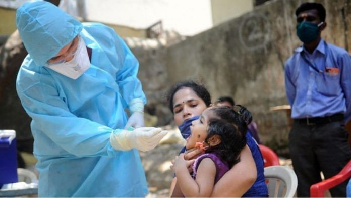 A medic takes a child's swab to test for Covid-19 | Representational image | PTI