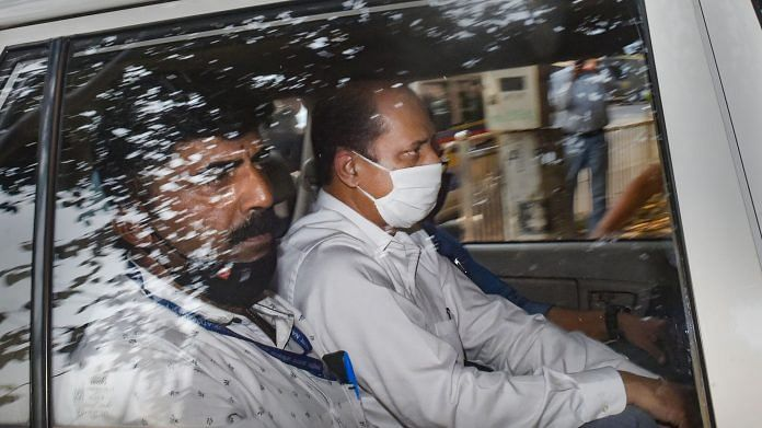 Police officer Sachin Vaze being taken to court by NIA for hearing in Mumbai, on 14 March 2021