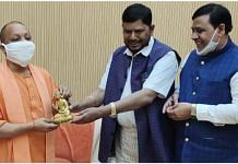 UP Chief Minister Yogi Adityanath (left) with RPI(A) chief Ramdas Athawale (centre) in Lucknow | By special arrangement