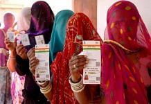 Women in Rajasthan stand in a queue with their Aadhaar cards   Representational image   PTI