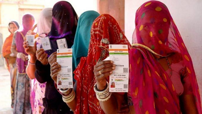 Women in Rajasthan stand in a queue with their Aadhaar cards | Representational image | PTI
