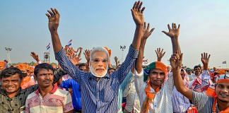 File photo | BJP supporters during PM Modi's election rally ahead of the Assam Assembly polls, at Sipajhar in Darrang district | PTI