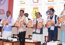 BJP president J.P. Nadda (third from right), Assam CM Sarbananda Sonowal (third from left), state minister Himanta Biswa Sarma (second from left) and other leaders release the party's assembly polls manifesto in Guwahati Tuesday | PTI
