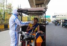A health worker takes samples from an e-rickshaw driver for Covid test in Delhi-Noida border on 25 March 2021 | Suraj Singh Bisht | ThePrint
